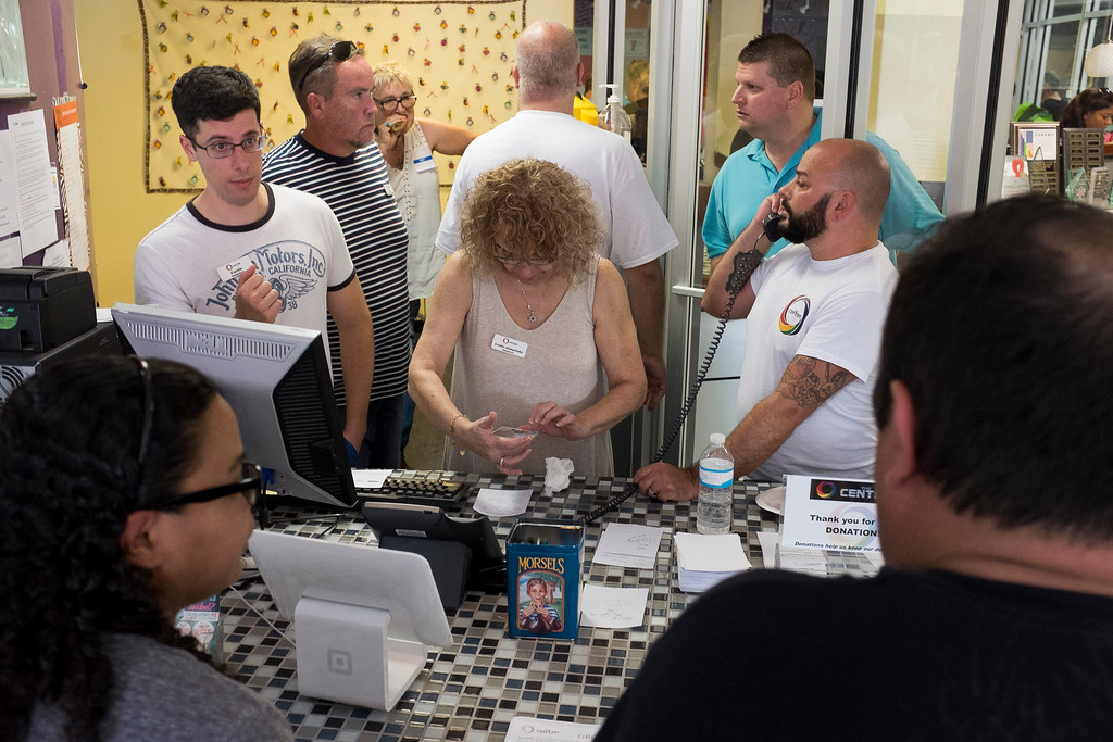. Volunteers provide counseling and field phone calls at The LGBTQ Community Center after the late night shooting at Pulse, an Orlando night club, on Sunday, June 12, 2016 in Orlando. A gunman wielding an assault-type rifle and a handgun opened fire inside a crowded Florida nightclub before dying in a gunfight with SWAT officers, police say. The attack left at least 50 people dead, making it the worst mass shooting in American history. (Zack Wittman/Tampa Bay Times via AP)