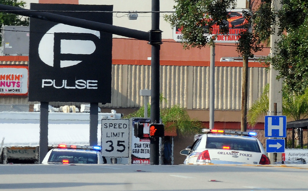 . ORLANDO, FL - JUNE 12:  Orlando police officers seen outside of Pulse nightclub after a fatal shooting and hostage situation on June 12, 2016 in Orlando, Florida. The suspect was shot and killed by police. (Photo by Gerardo Mora/Getty Images)