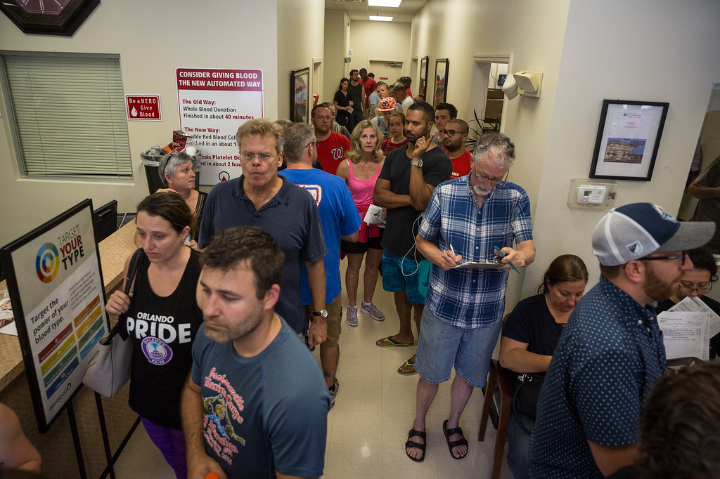 . Donors line up outside OneBlood Blood Donation Center in Orlando, Fla., on Sunday, June 12, 2016. The center was flooded with donors after a mass shooting early Sunday morning at a gay nightclub, Pulse, in Orlando. A gunman wielding an assault-type rifle and a handgun opened fire inside the nightclub early Sunday, killing at least 50 people before dying in a gunfight with SWAT officers, police said. It was the worst mass shooting in American history. (Loren Elliott/Tampa Bay Times via AP)