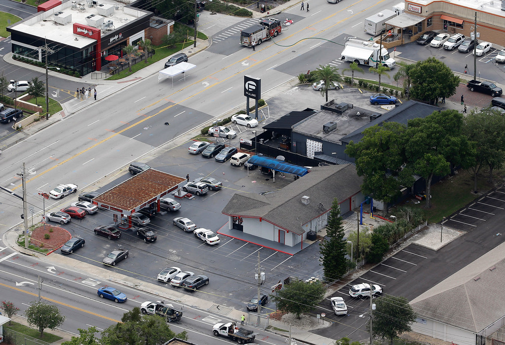 . Law enforcement officials work at the Pulse nightclub following a fatal shooting Sunday, June 12, 2016, in Orlando, Fla. . (AP Photo/Chris O\'Meara)