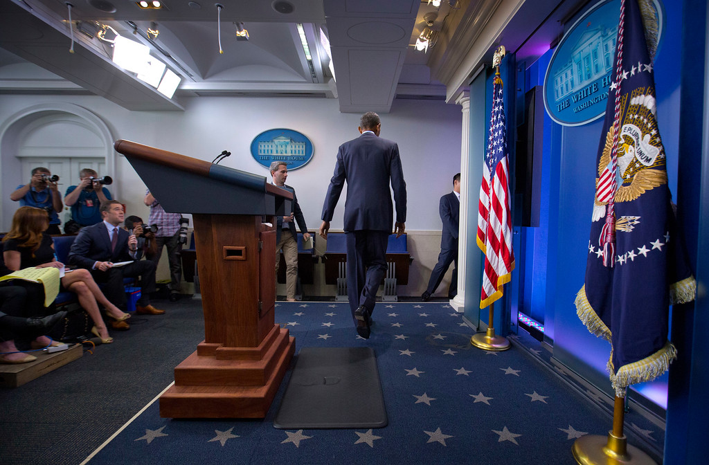 . President Barack Obama walks away from his podium after speaking about the massacre at a Orlando nightclub during a news conference at the White House in Washington, Sunday, June 12, 2016. (AP Photo/Pablo Martinez Monsivais)