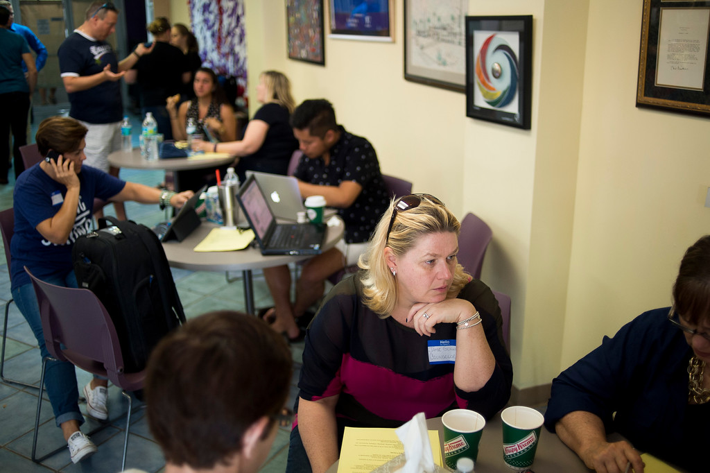 . Volunteers provide counseling at The LGBTQ Community Center after the late night shooting at Pulse, an Orlando night club, on Sunday, June 12, 2016 in Orlando. A gunman wielding an assault-type rifle and a handgun opened fire inside a crowded Florida nightclub before dying in a gunfight with SWAT officers, police say. The attack left at least 50 people dead, making it the worst mass shooting in American history. (Zack Wittman/Tampa Bay Times via AP)