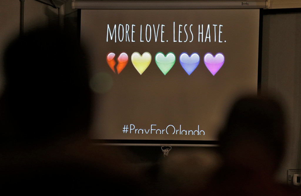 . A message of the screen during a prayer vigil at the Joy Metropolitan Community Church after a fatal shooting at the Pulse Orlando nightclub Sunday, June 12, 2016, in Orlando, Fla. (AP Photo/Chris O\'Meara)