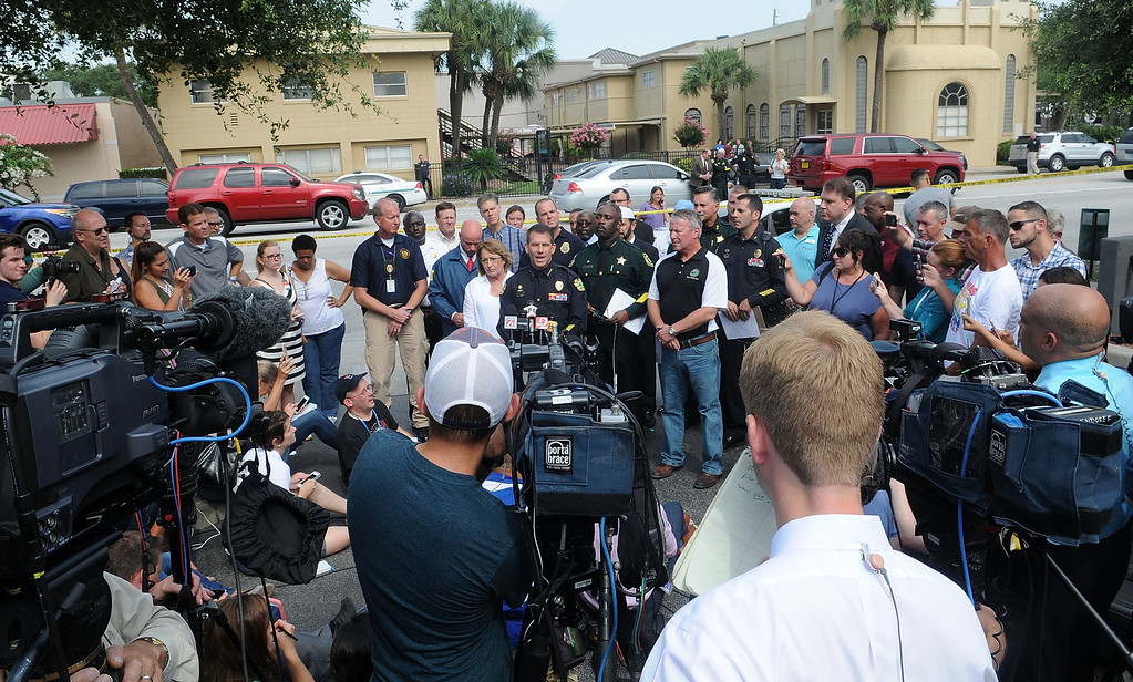 . ORLANDO, FLORIDA - JUNE 12: Orlando Police Chief John Mina (C), law enforcement and local community leaders speak during a press conference June 12, 2016 in Orlando, Florida. 50 people are reported dead and 53 were injured at a mass shooting at the Pulse nightclub in what is now the worst mass shooting in U.S. history. The suspected shooter, Omar Mateen, was shot and killed by police. (Photo by Gerardo Mora/Getty Images)