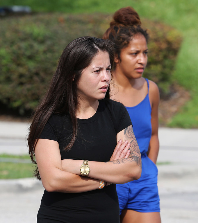 . Concerned friends and family of victims at the Pulse nightclub, where multiple fatalities were reported after a shooting, wait outside of the Orlando Police Department, Sunday, June 12, 2016, in Orlando, Fla. (Joe Burbank/Orlando Sentinel via AP)