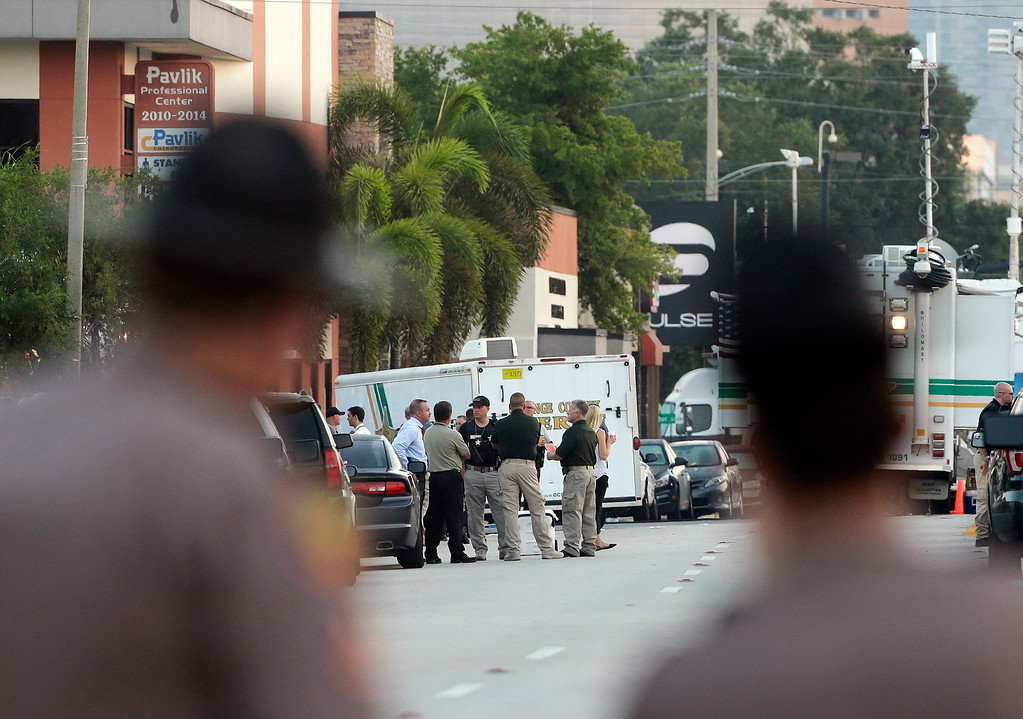 . Members of the Florida Highway Patrol continue to block Orange Avenue as other law enforcement officials confer near the Pulse Orlando nightclub Monday, June 13, 2016, in Orlando, Fla. Pulse Orlando was the scene of a mass fatal shooting early Sunday morning. (AP Photo/Chris O\'Meara)