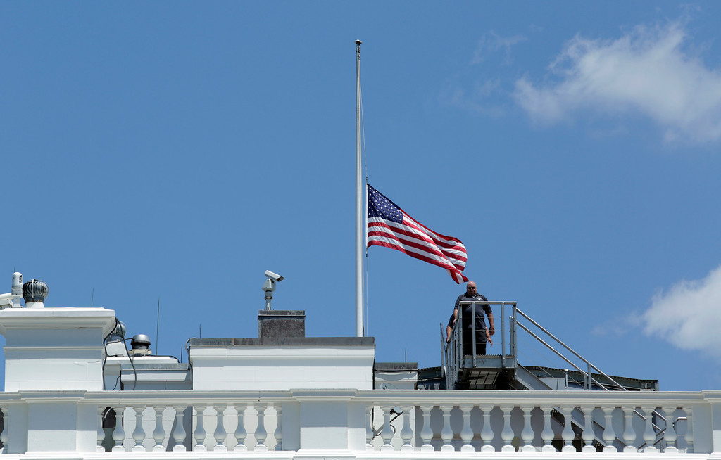 . Personnel leave after lowering the US flag to half-staff at the the White House in Washington, DC following US President Barack Obama\'s statement on the mass shooting at an Orlando, Florida nightclub on June 12, 2016.  Fifty people died in the worst mass shooting in US history Sunday when a suspected Islamist gunman opened fire inside a gay nightclub. (YURI GRIPAS/AFP/Getty Images)