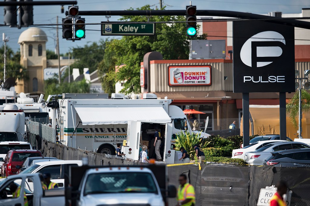 . Investigators work at the Pulse nightclub June 13, 2016 in Orlando, Florida. Forty-nine people died and more than 50 were injured early June 12 when a heavily-armed gunman opened fire and seized hostages at a gay nightclub in Orlando, Florida, in the worst mass shooting in US history. (BRENDAN SMIALOWSKI/AFP/Getty Images)