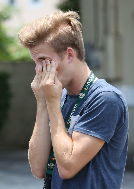 . A man grieves for victims of the mass shooting just a block from the scene in Orlando, Florida, on June 12, 2016.  Fifty people died and another 53 were injured when a gunman opened fire and seized hostages at a gay nightclub in Florida, police said June 12, making it the worst mass shooting in US history. (GREGG NEWTON/AFP/Getty Images)