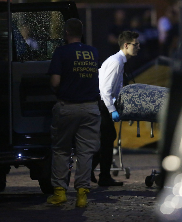 . ORLANDO, FL - JUNE 12:  A member of the Medical Examiners office wheels a body to a vehicle from the mass shooting at Pulse Nightclub where Omar Mateen allegedly killed at least 50 people on June 12, 2016 in Orlando, Florida. The mass shooting killed at least 50 people and injuring 53 others in what is the deadliest mass shooting in the country�s history.  (Photo by Joe Raedle/Getty Images)