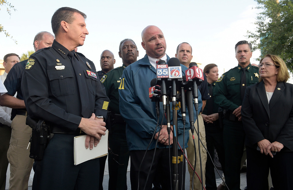 . FBI assistant special agent in charge Ron Hopper, center, answers questions from members of the media after a fatal shooting at Pulse Orlando nightclub in Orlando, Fla., Sunday, June 12, 2016. Listening are Orlando Police Chief John Mina, left, and Orange County Mayor Teresa Jacobs. (AP Photo/Phelan M. Ebenhack)