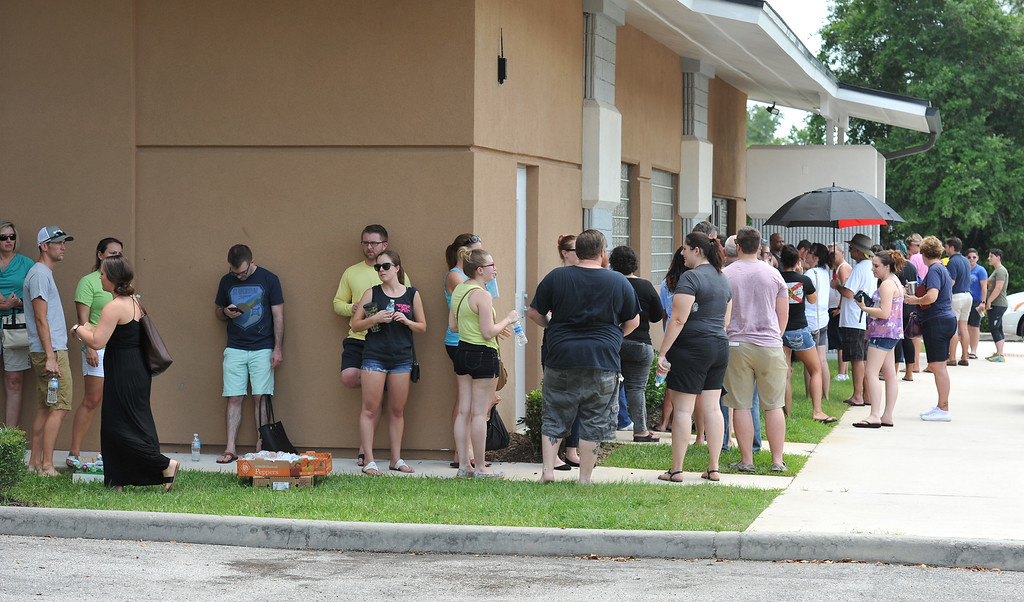. Potential blood donors line up outside the oneblood facility on Beach Blvd. In Jacksonville, Fla., Sunday, June 12, 2016, to help the victims from the shooting at a nightclub in Orlando. A gunman wielding an assault-type rifle and a handgun opened fire inside a gay nightclub early Sunday, killing at least 50 people before dying in a gunfight with SWAT officers, police said. It was the worst mass shooting in American history. (Bob Self/The Florida Times-Union via AP)