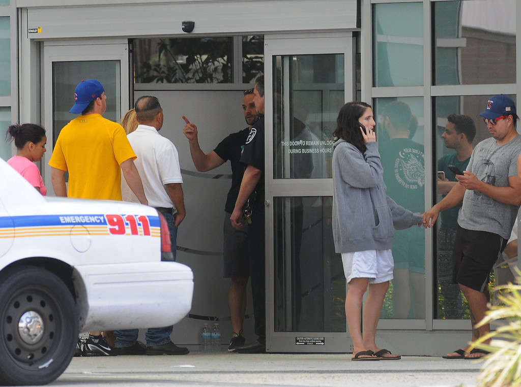 . ORLANDO, FLORIDA - JUNE 12:  Families and friends await for information outside of the Orlando Regional Medical Center about loved ones who may have been victims of the mass shooting at the Pulse nightclub on June 12, 2016 in Orlando, Florida. The suspected shooter, Omar Mateen, was shot and killed by police. 50 people are reported dead and 53 were injured in what is now the worst mass shooting in U.S. history. (Photo by Gerardo Mora/Getty Images)