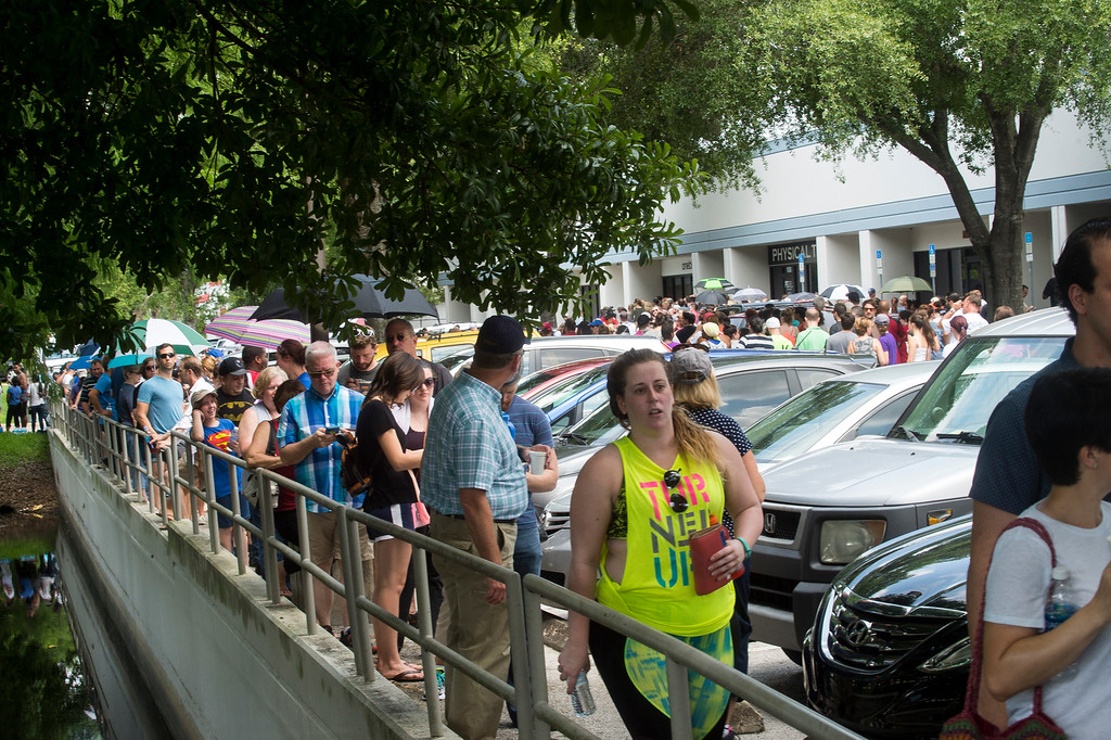 . Hundreds of volunteers line up to donate blood at OneBlood Center after the late night shooting at Pulse, an Orlando night club, Sunday, June 12, 2016, in Orlando. A gunman wielding an assault-type rifle and a handgun opened fire inside a crowded Florida nightclub before dying in a gunfight with SWAT officers, police say. The attack left at least 50 people dead, making it the worst mass shooting in American history. (Zack Wittman/Tampa Bay Times via AP)