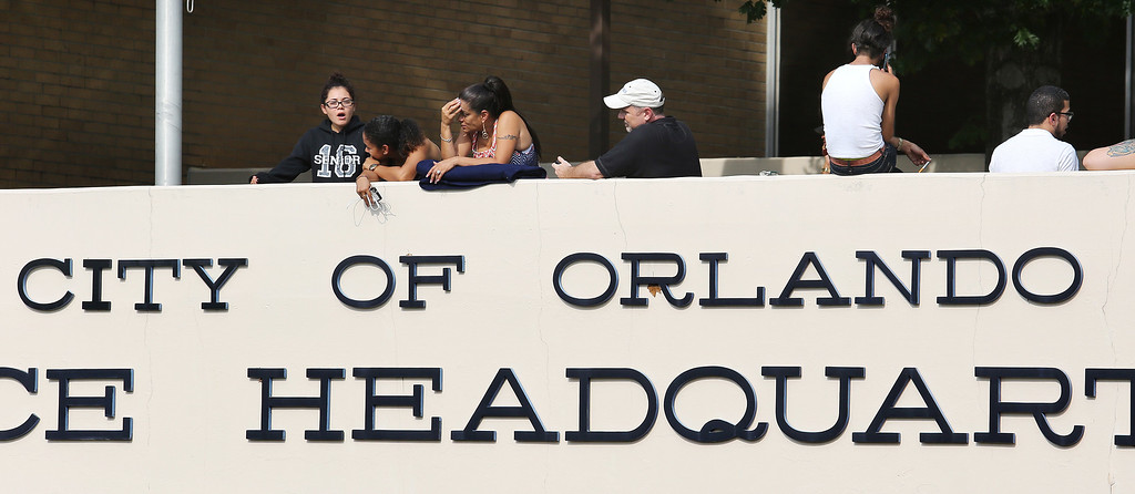 . Concerned friends and family of victims at the Pulse nightclub, where multiple fatalities were reportedly after a shooting, wait outside of the Orlando Police Department, Sunday, June 12, 2016, in Orlando, Fla. (Joe Burbank/Orlando Sentinel via AP)