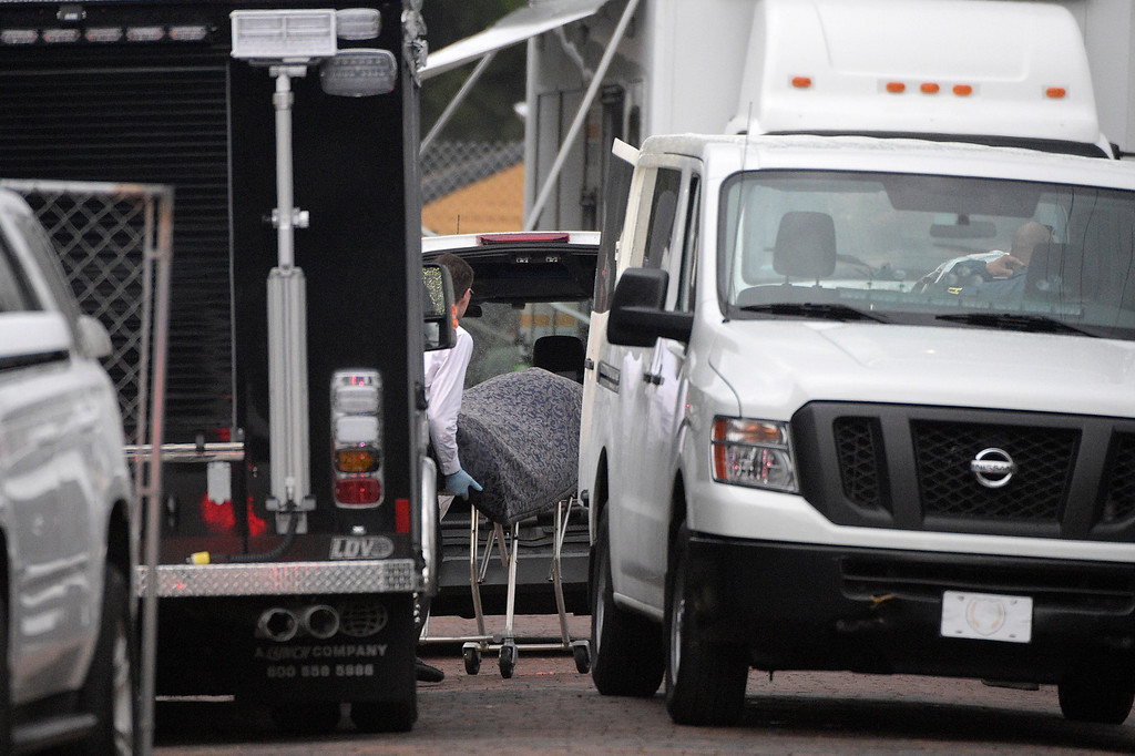 . A body is loaded into a van outside the Pulse nightclub after a shooting involving multiple fatalities at the nightclub in Orlando, Fla., Sunday, June 12, 2016. (AP Photo/Phelan M. Ebenhack)