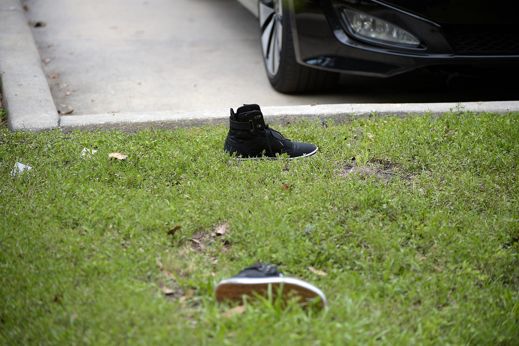 . A pair of shoes sit in a parking lot outside Pulse Orlando after a shooting involving multiple fatalities at the nightclub in Orlando, Fla., Sunday, June 12, 2016. (AP Photo/Phelan M. Ebenhack)