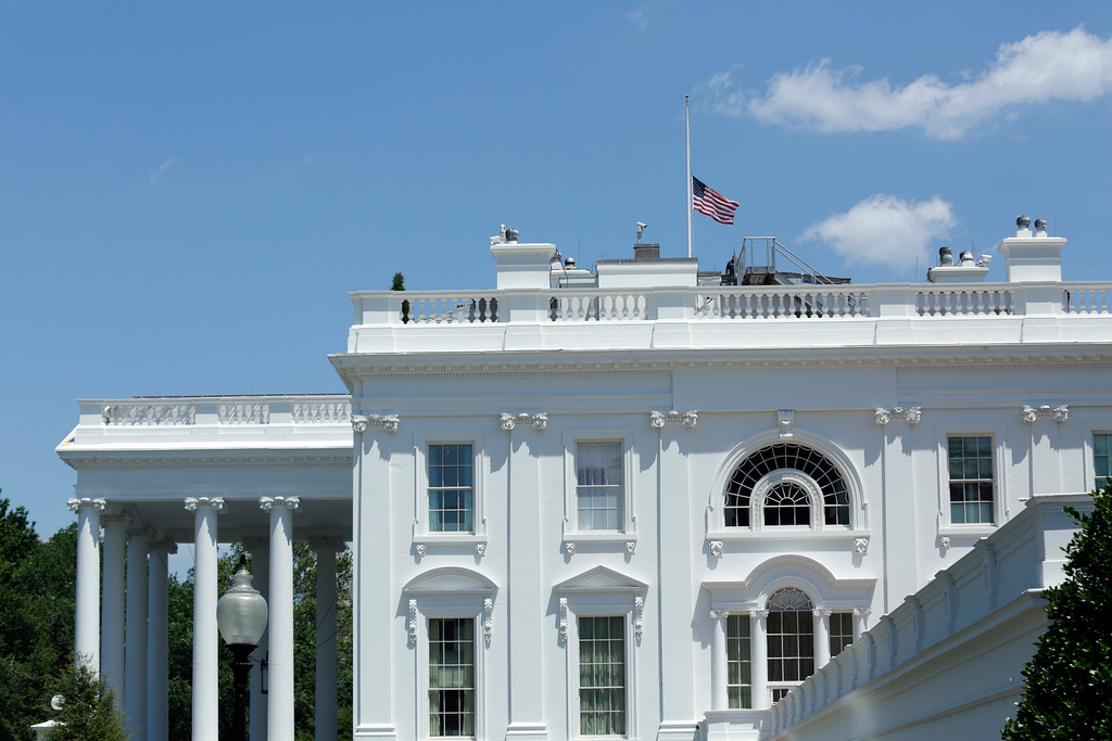 . The US flag is seen at half-staff at the White House in Washington, DC following US President Barack Obama\'s statement on the mass shooting at an Orlando, Florida nightclub on June 12, 2016.  Fifty people died in the worst mass shooting in US history June 12 when a suspected Islamist gunman opened fire inside a gay nightclub. (YURI GRIPAS/AFP/Getty Images)