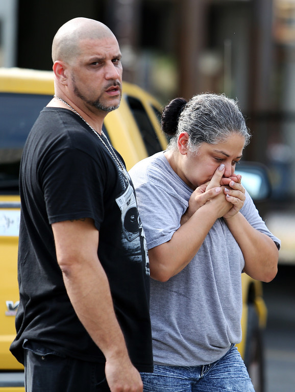 . Ray Rivera, left, a DJ at Pulse Orlando nightclub, is consoled by a friend, outside of the Orlando Police Department after a shooting involving multiple fatalities at the nightclub, Sunday, June 12, 2016, in Orlando, Fla. (Joe Burbank/Orlando Sentinel via AP)
