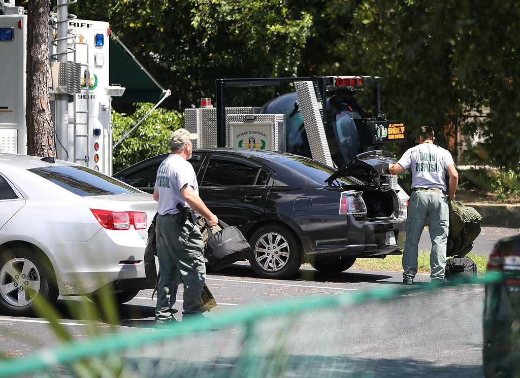 . FORT PIERCE, FL - JUNE 12:  Bomb Disposal personel arrive to check for explosives around the apartment building where shooting suspect Omar Mateen is believed to have lived on June 12, 2016 in Fort Pierce, Florida. The mass shooting at Pulse nightclub in Orlando, Florida killed at least 50 people and injured 53 others in what is the deadliest mass shooting in the country\'s history.  (Photo by Joe Raedle/Getty Images)
