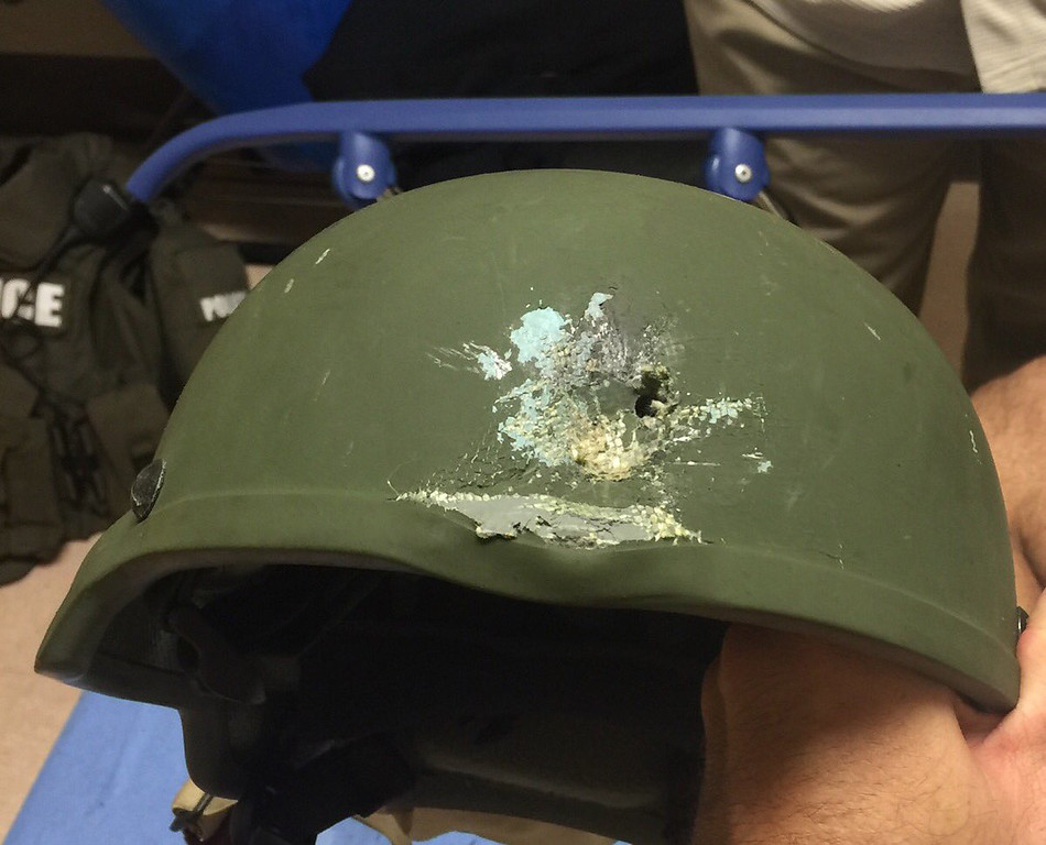 . This image provided by the Orlando Police Department shows the helmet an officer in Orlando, Fla., was wearing when responding to the shooting at Pulse Nightclub on Sunday, June 12, 2016. The attack is the worst mass shooting in American history. (Orlando Police Department via AP)