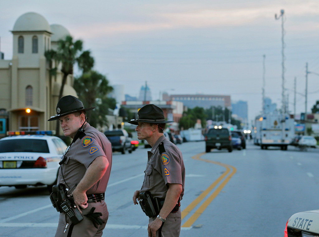 . Members of the Florida Highway Patrol continue to block Orange Avenue near the Pulse Orlando nightclub before sunrise Monday, June 13, 2016, in Orlando, Fla. Pulse Orlando was the scene of a mass fatal shooting early Sunday morning. (AP Photo/Chris O\'Meara)