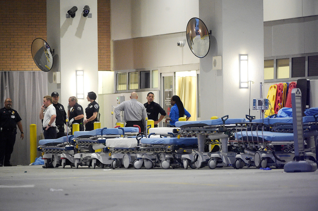 . Emergency personnel wait with stretchers at the emergency entrance to Orlando Regional Medical Center hospital for the arrival of patients from the scene of a fatal shooting at Pulse Orlando nightclub in Orlando, Fla., Sunday, June 12, 2016. (AP Photo/Phelan M. Ebenhack)