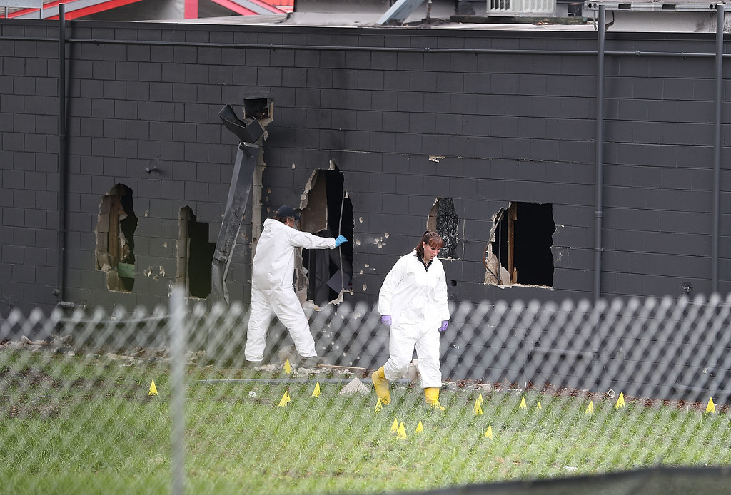 . ORLANDO, FL - JUNE 12:  FBI agents investigate near the damaged rear wall of the Pulse Nightclub where Omar Mateen allegedly killed at least 50 people on June 12, 2016 in Orlando, Florida. The mass shooting killed at least 50 people and injuring 53 others in what is the deadliest mass shooting in the country\'s history.  (Photo by Joe Raedle/Getty Images)