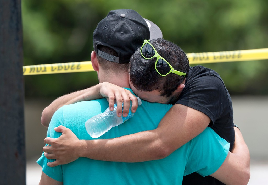 . Supported by a friend, a man weeps for victims of the mass shooting just a block from the scene in Orlando, Florida, on June 12, 2016.  Fifty people died and another 53 were injured when a gunman opened fire and seized hostages at a gay nightclub in Florida, police said June 12, making it the worst mass shooting in US history. (GREGG NEWTON/AFP/Getty Images)