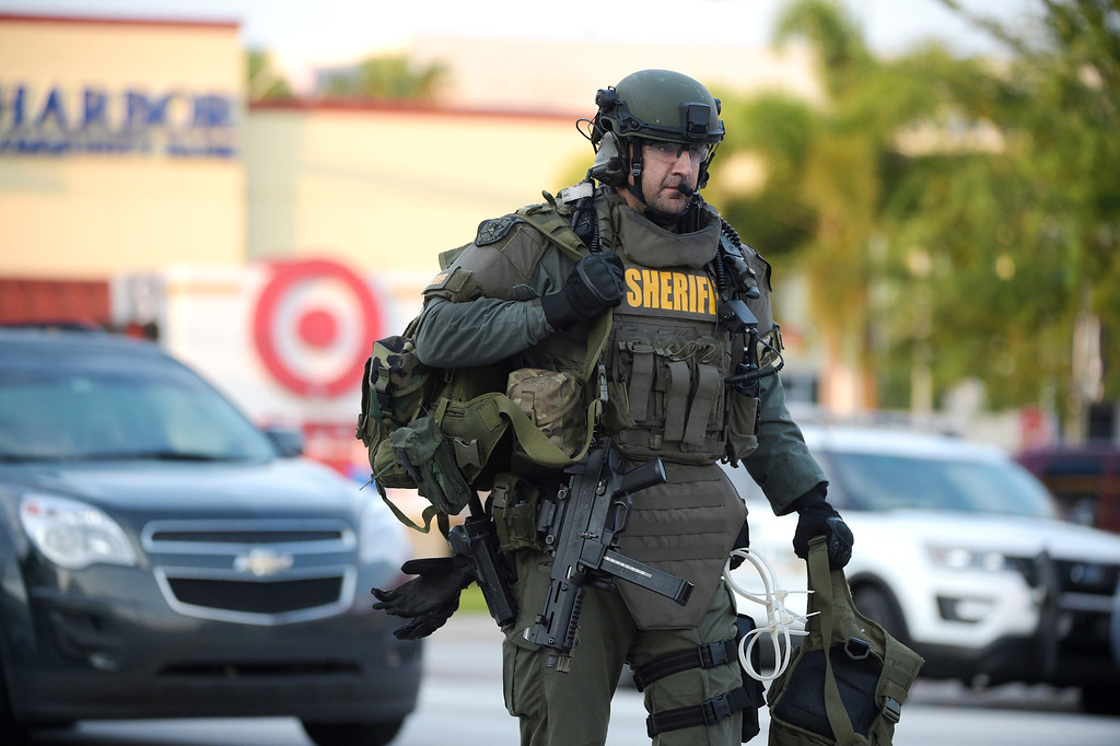 . An Orange County Sheriff\'s Department SWAT member arrives to the scene of a fatal shooting at Pulse Orlando nightclub in Orlando, Fla., Sunday, June 12, 2016. (AP Photo/Phelan M. Ebenhack)