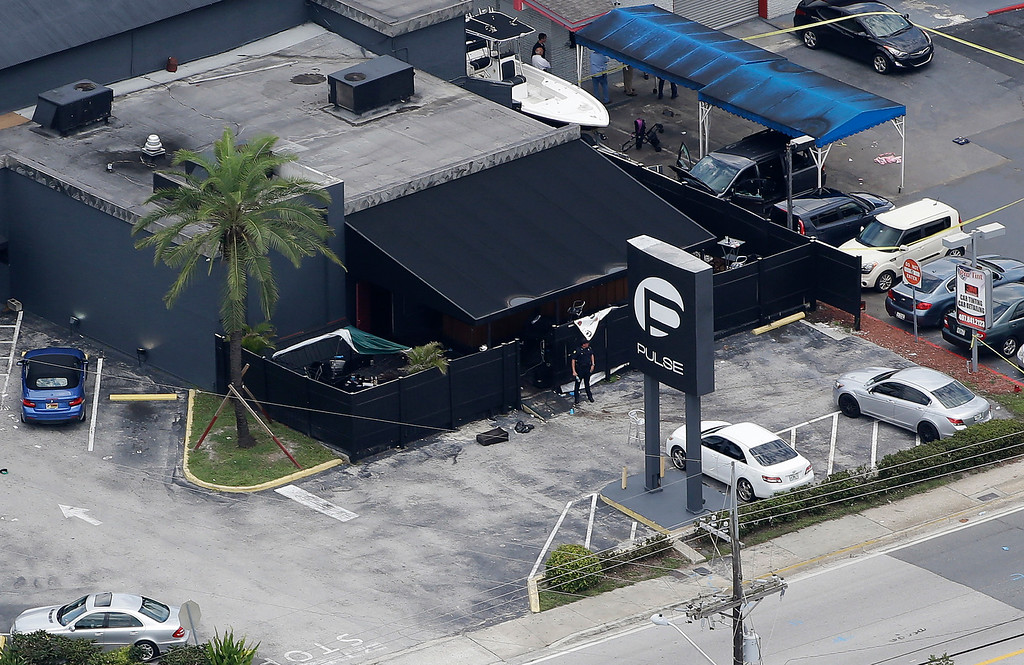 . In this June 12, 2016 file photo, law enforcement officials work at the Pulse gay nightclub in Orlando, Fla., following the a mass shooting. Audio recordings of 911 calls released Tuesday, Aug. 30, by the Orange County Sheriff\'s Office show mounting frustration by friends and family members who were texting, calling and video-chatting with trapped patrons of the Pulse nightclub where Omar Mateen opened fire in June. (AP Photo/Chris O\'Meara, File)