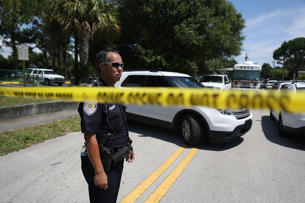 . FORT PIERCE, FL - JUNE 12:  Police tape marks off the entrance to the apartment building where shooting suspect Omar Mateen is believed to have lived on June 12, 2016 in Fort Pierce, Florida. The mass shooting at Pulse nightclub in Orlando, Florida killed at least 50 people and injured 53 others in what is the deadliest mass shooting in the country\'s history.  (Photo by Joe Raedle/Getty Images)