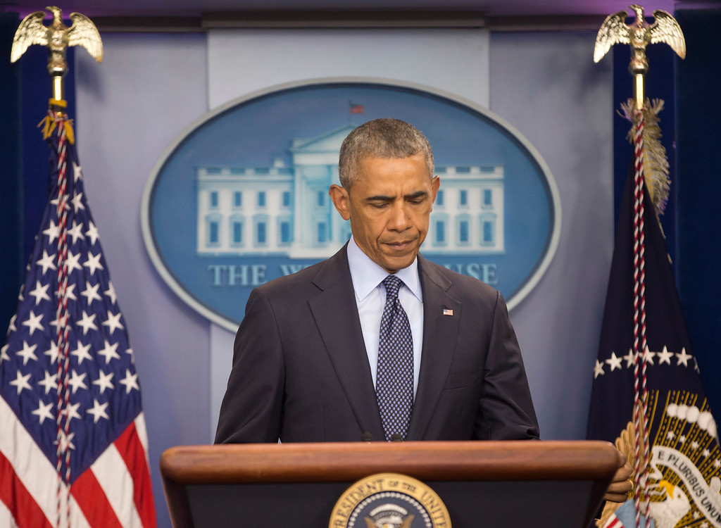 . President Barack Obama approaches his podium to begin to speak about the massacre at a Orlando nightclub during a news conference at the White House in Washington, Sunday, June 12, 2016. (AP Photo/Pablo Martinez Monsivais)