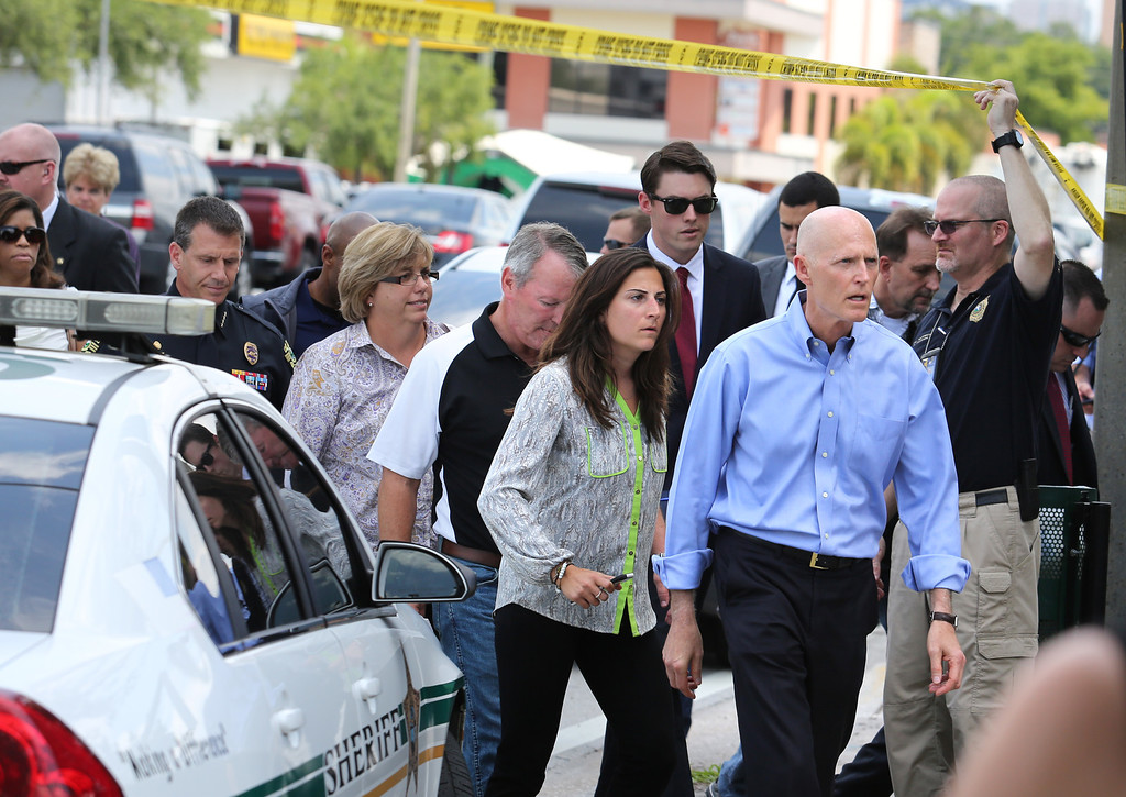. Florida  Gov. Rick Scott arrives on the scene near the nightclub where a mass shooting occured in Orlando, Fla., Sunday, June 12, 2016. A gunman wielding an assault-type rifle and a handgun opened fire inside a crowded gay nightclub early Sunday, before dying in a gunfight with SWAT officers, police said. It was the worst mass shooting in American history. (Joe Burbank/Orlando Sentinel via AP)