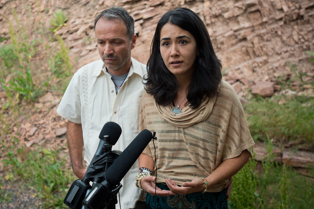 . Sitora Yusufiy, the ex-wife of Orlando shooting suspect Omar Mateen, and her fiance Marcio Dias, give a statement to the media at their home outside Boulder, Colo., Sunday, June 12, 2016. (Autumn Parry/Boulder Daily Camera via AP)