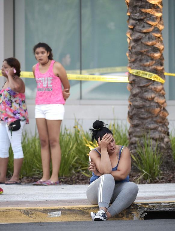 . People wait outside the emergency entrance of the Orlando Regional Medical Center hospital after a shooting involving multiple fatalities at Pulse Orlando nightclub in Orlando, Fla., Sunday, June 12, 2016. (AP Photo/Phelan M. Ebenhack)