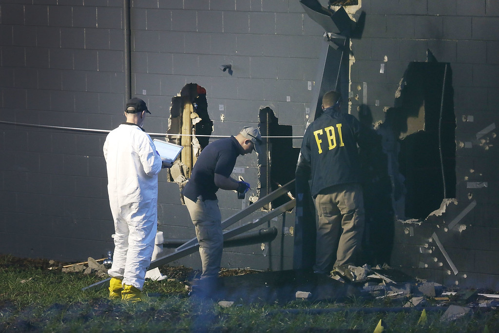 . ORLANDO, FL - JUNE 12:  FBI agents investigate near the damaged rear wall of the Pulse Nightclub where Omar Mateen allegedly killed at least 50 people on June 12, 2016 in Orlando, Florida. The mass shooting killed at least 50 people and injuring 53 others in what is the deadliest mass shooting in the country�s history.  (Photo by Joe Raedle/Getty Images)