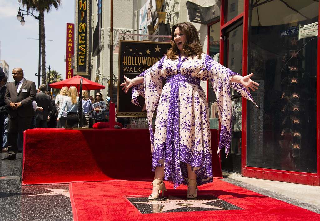 . Melissa McCarthy poses on her star after it was unveiled at a ceremony on the Hollywood Walk of Fame in Hollywood, California, May 19, 2015.           (ROBYN BECK/AFP/Getty Images)