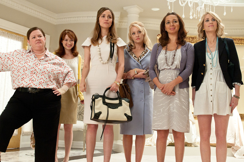 ". In this publicity image released by Universal Pictures, from left, Melissa McCarthy, Ellie Kemper, Rose Byrne, Wendi McLendon-Covey, Maya Rudolph and Kristen Wiig are shown in a scene from ""Bridesmaids.\"" (AP Photo/Universal Pictures, Suzanne Hanover)"