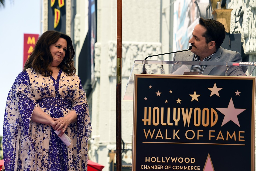 . Melissa McCarthy reacts as her husband, actor Ben Falcone, speaks at a her star unveiling ceremony on the Hollywood Walk of Fame in Hollywood, California, May 19, 2015.           (ROBYN BECK/AFP/Getty Images)