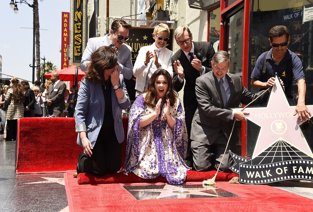 . Melissa McCarthy (C) reacts as her star is unveiled at a ceremony on the Hollywood Walk of Fame in Hollywood, California, May 19, 2015. With McCarthy are Ellen DeGeneres (C back row), director Paul Feig (R back row), Ben Falcone (L back row) and Hollywood Chamber of Commerce, President/CEO Leron Gubler (2R).           (ROBYN BECK/AFP/Getty Images)