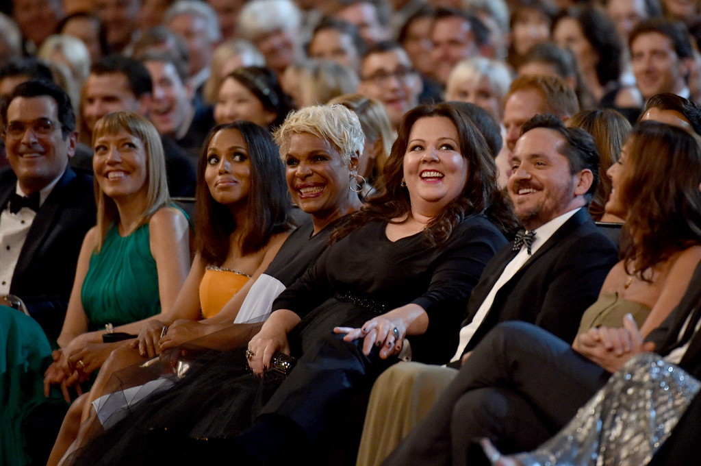 . Ty Burrell, and from left, Holly Anne Brown, Kerry Washington, guest, Melissa McCarthy, and Ben Falcone in the audience at the 66th Primetime Emmy Awards at the Nokia Theatre L.A. Live on Monday, Aug. 25, 2014, in Los Angeles. (Photo by John Shearer/Invision for the Television Academy/AP Images)