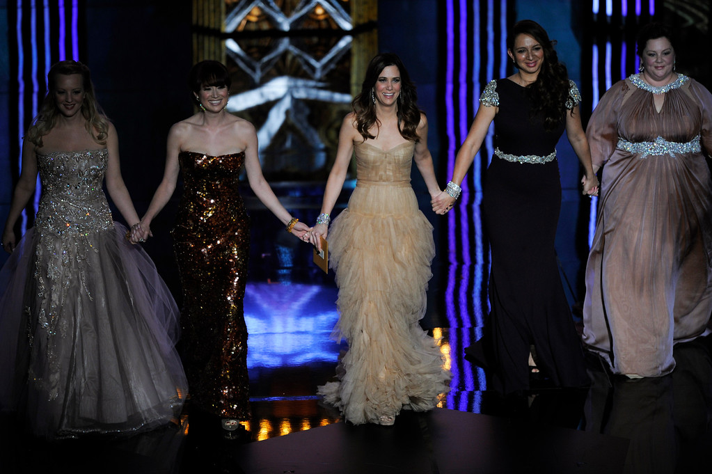 ". Members of the cast of ""Bridesmaids\"" left to right, Wendi McLendon-Covey, Ellie Kemper, Kristen Wiig, Maya Rudolph and Melissa McCarthy present an award during the 84th Academy Awards on Sunday, Feb. 26, 2012, in the Hollywood section of Los Angeles. (AP Photo/Mark J. Terrill)"