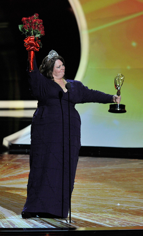 . Melissa McCarthy (C) accepts the Outstanding Lead Actress in a Comedy Series award onstage  during the 63rd Primetime Emmy Awards show at the Nokia Theatre in Los Angeles, California on September 18, 2011.   (John McCoy/Los Angeles Daily News)