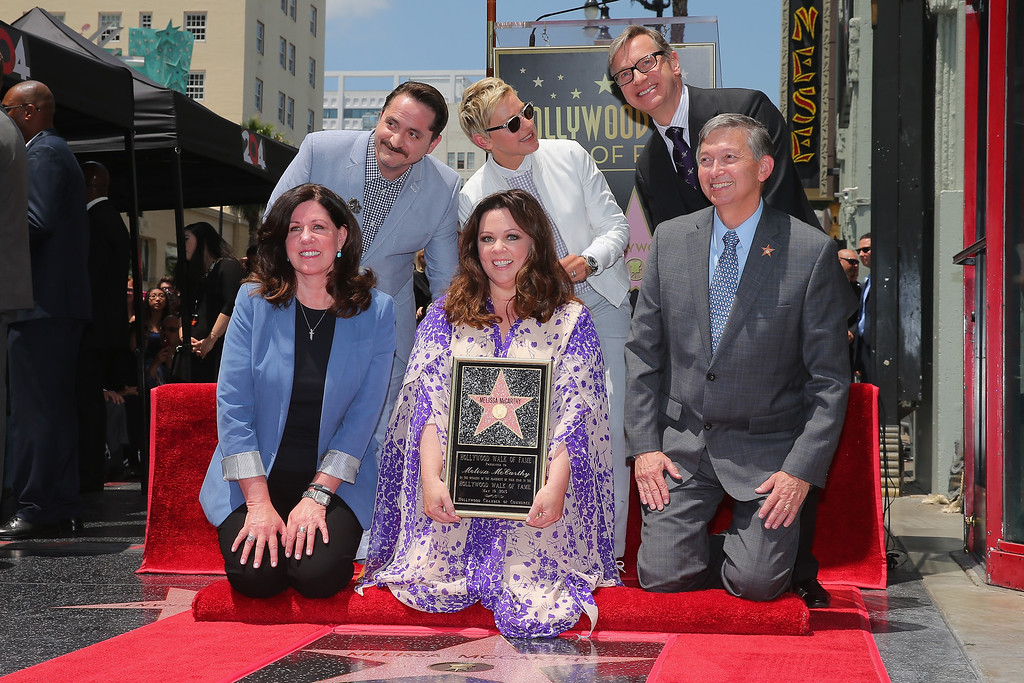 . Actress Melissa McCarthy (C) poses with Ben Falcone (back, left), Ellen DeGeneres (back, center), director Paul Feig (back, right) and Hollywood Chamber of Commerce, President/CEO Leron Gubler (R) as she is honored with a star on the Hollywood Walk Of Fame on May 19, 2015 in Hollywood, California.  (Photo by Mark Davis/Getty Images)