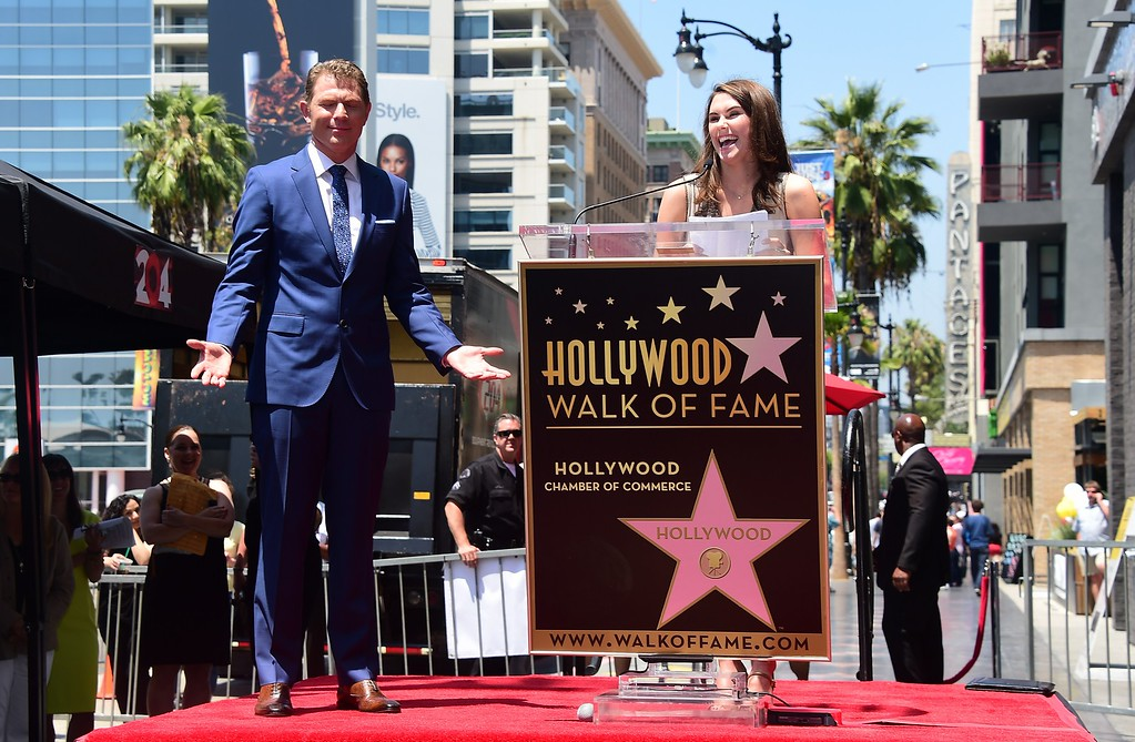 . Chef Bobby Flay reacts as his daughter Sophie speaks during his Hollywood Walk of Fame Star ceremony on June 2, 2015, in Hollywood, California. Flay is the first television chef to be accorded the honor.         (FREDERIC J. BROWN/AFP/Getty Images)