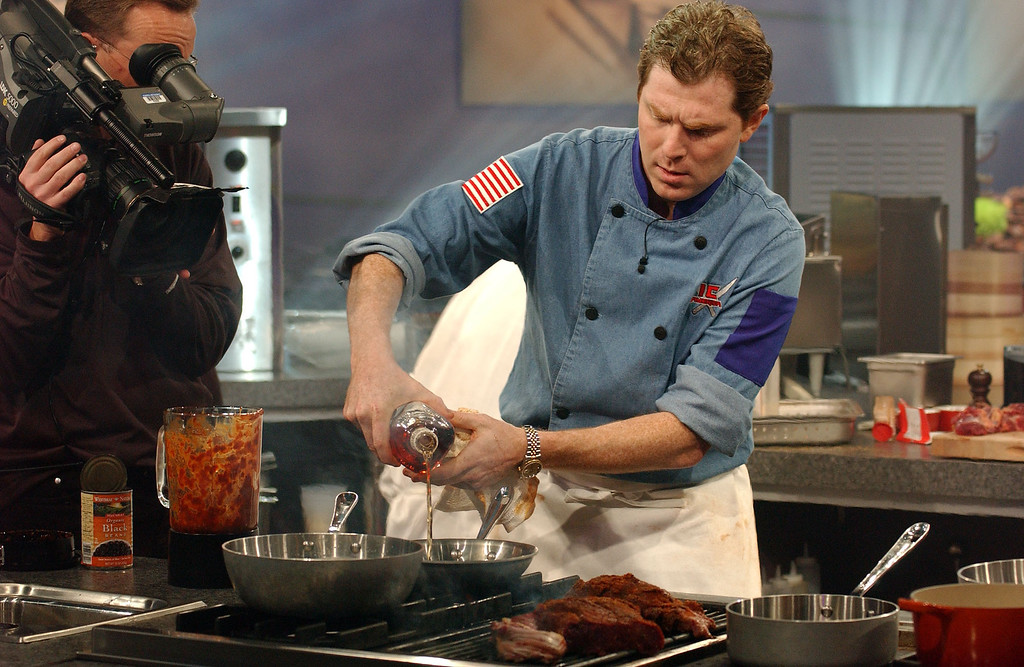 ". Iron Chef Bobby Flay of Mesa Grill in New York works on the grill during the taping of the ""Iron Chef America\"" in New York, Oct. 13, 2004.  (AP Photo/Jim Cooper)"