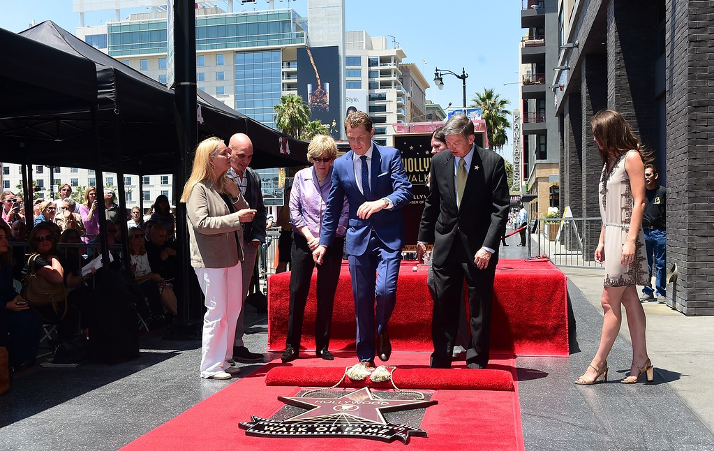 . Chef Bobby Flay (C) during the unveiling of his star on the Hollywood Walk of Fame on June 2, 2015, in Hollywood, California. Flay is the first television chef to be accorded the honor.        (FREDERIC J. BROWN/AFP/Getty Images)