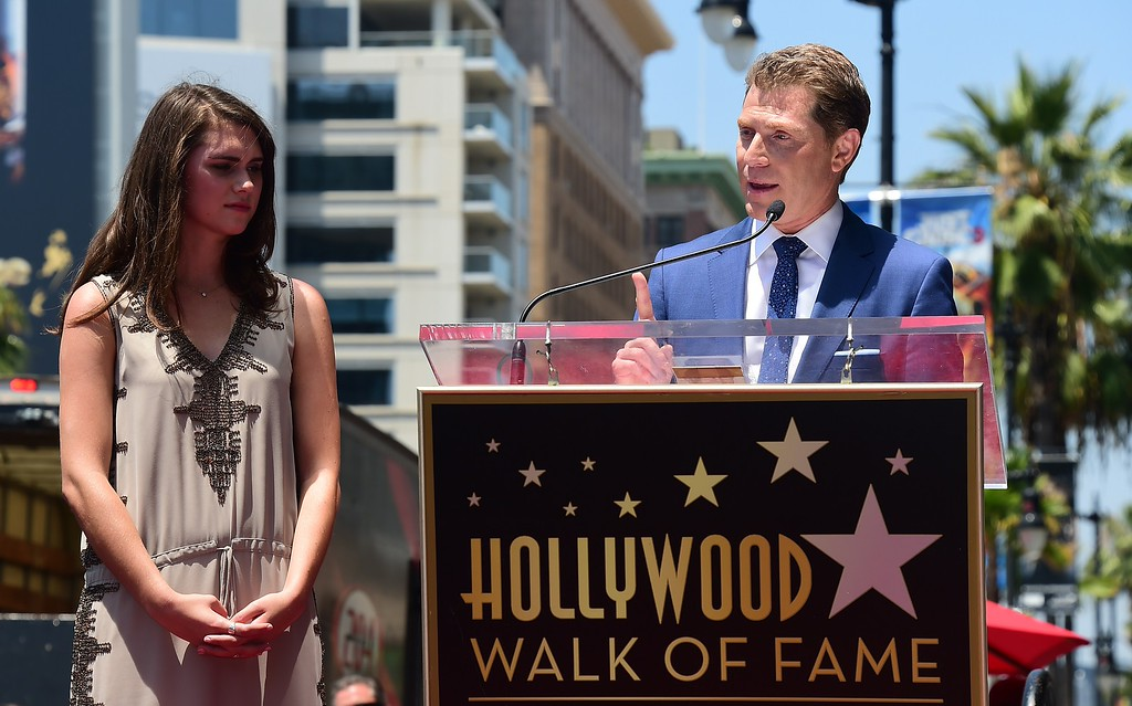 . Chef Bobby Flay speaks as his daughter Sophie listens during a Hollywood Walk of Fame ceremony on June 2, 2015, in Hollywood, California. Flay is the first television chef to be accorded the honor.        (FREDERIC J. BROWN/AFP/Getty Images)