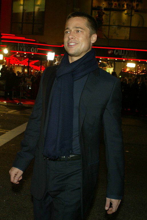 ". HOLLYWOOD - JANUARY 12:  Actor Brad Pitt attends the Los Angeles premiere of Universal Pictures\' film ""Along Came Polly\"" at the Grauman\'s Chinese Theatre January 12, 2004 in Hollywood, California.  (Photo by Kevin Winter/Getty Images)"